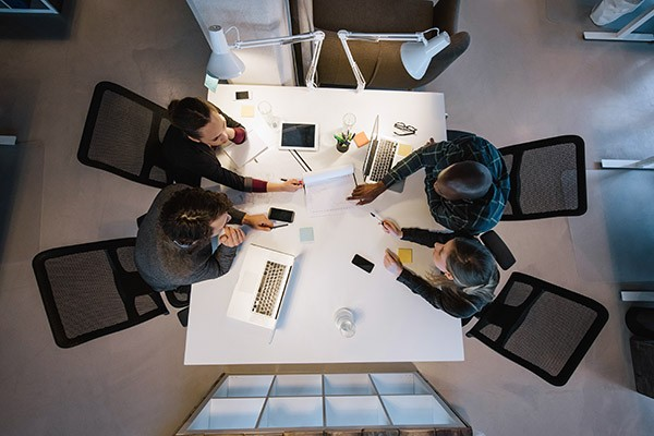 team-collaboration-at-table-from-above